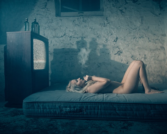 Picture of woman laying in bed; how to stop dopamine addiction