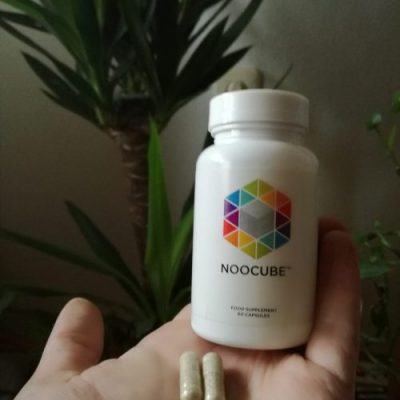 NooCube supplement with two capsules in my hand
