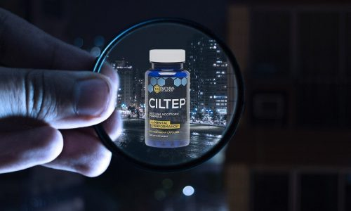 close up of hand that hold magnifier in which centre is CILTEP bottle