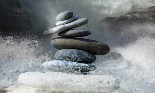 stack of eight rocks fluttered by the waves